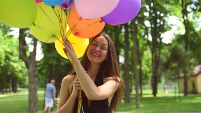 charming girl with colorful balloons - latex stock videos & royalty-free footage