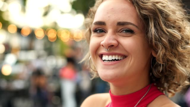 charming smile of latin woman - piercing video stock e b–roll
