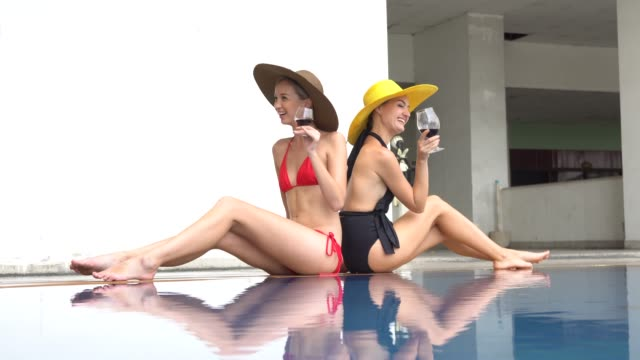 charming woman and relax at pool - bikini stock videos & royalty-free footage