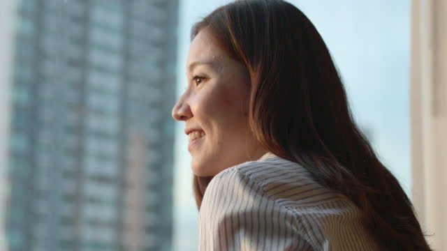 charming woman of asian ethnicity. opening the curtains, looking at the window in the morning, smiling at the lifestyle, natural beauty, feeling at home - looking stock videos & royalty-free footage