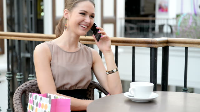 charming woman talking on the phone regarding your purchase. - blouse stock videos & royalty-free footage
