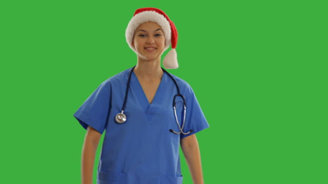 charming young doctor showing copy space - santa hat stock videos & royalty-free footage