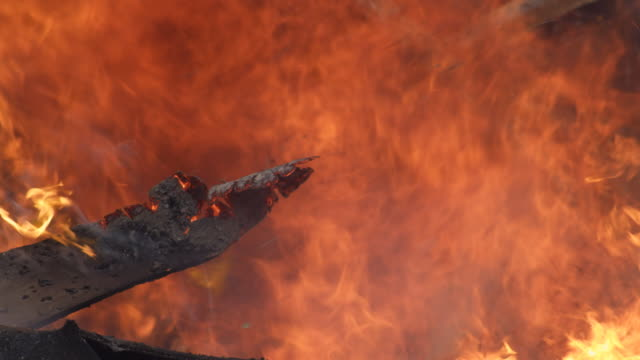 a charred board blazes against a background of flame - myrtle creek stock videos & royalty-free footage