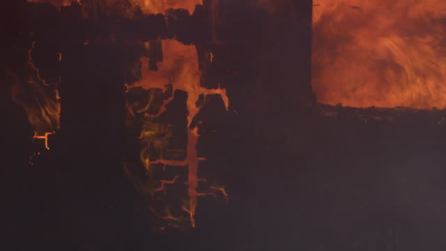 charred end wall of a building nearly consumed by roaring flames - myrtle creek stock videos & royalty-free footage