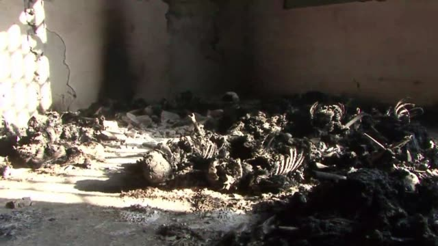 charred skeletons of some 50 people are found in a makeshift prison next to a libyan military base abandoned by elite troops loyal to moamer kadhafi... - burnt stock videos & royalty-free footage