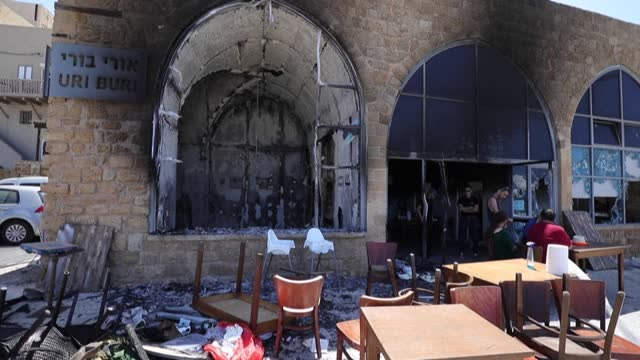 charred uri buri restaurant after it was attacked and damaged during night riots between arab israelis and israeli far-right groups in the mixed... - middle eastern ethnicity stock videos & royalty-free footage