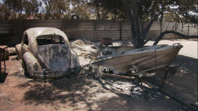 charred vehicles sit in a driveway after the eyre peninsula bushfire. - rubble stock videos & royalty-free footage