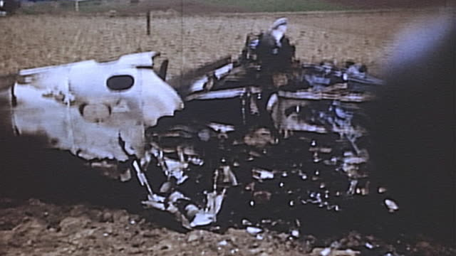 charred wreckage of destroyed german fighter plane with pieces still burning during wwii european campaign / germany - ドイツ国防軍 空軍点の映像素材/bロール