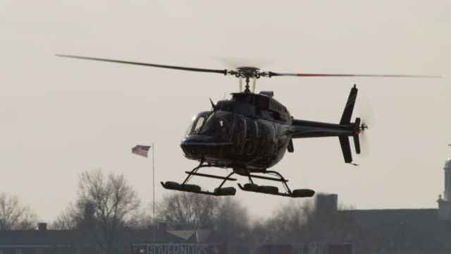 a charter helicopter takes off at the south street seaport helipad at the south tip of manhattan. - helicopter landing stock videos & royalty-free footage