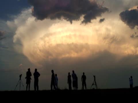 Chasers watching amazing supercell storm at sunset, WA, USA