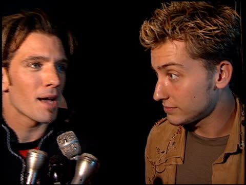 jc chasez at the 'n sync celebrity album party at moomba in west hollywood california on july 23 2001 - jc chasez stock-videos und b-roll-filmmaterial