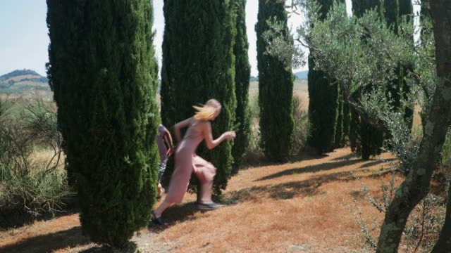 chasing girlfriend through summer meadow - tuscany stock videos and b-roll footage