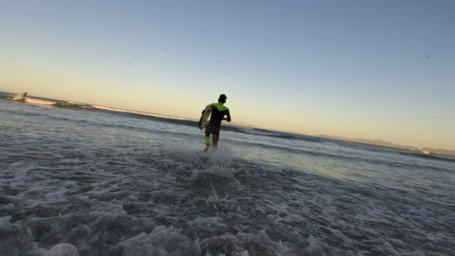 chasing the early morning waves - water sport stock videos & royalty-free footage