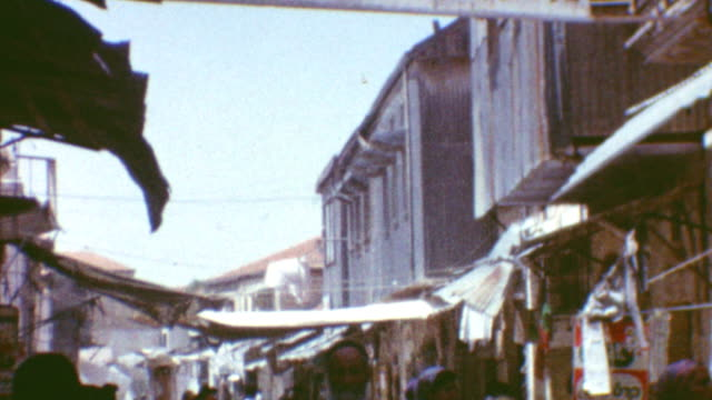 stockvideo's en b-roll-footage met chassidic children playing / signage warning about modesty / mea shearim street scenes / ultraorthodox mea shearim on may 04 1962 in jerusalem israel - orthodox jodendom