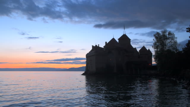 chateau de chillon (chillon castle) on the shore of lake geneva, sunset. - montreux stock videos and b-roll footage