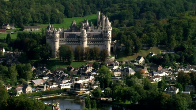 aerial chateau de pierrefonds and surrounding town/ pierrefonds, france - circa 12th century stock videos & royalty-free footage