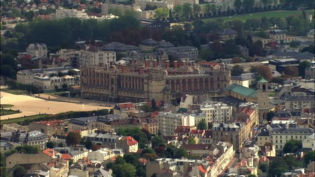 AERIAL Chateau de Saint-Germain-en-Laye, grounds, and surrounding area/ ZO cityscape with La Defense in background/ Saint-Germain-en-Laye, France