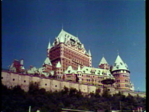 1953 MONTAGE LA WS Chateau Frontenac in Quebec / WS Tower of Victory and Peace and Parliament Building in Ottawa, Canada / AUDIO