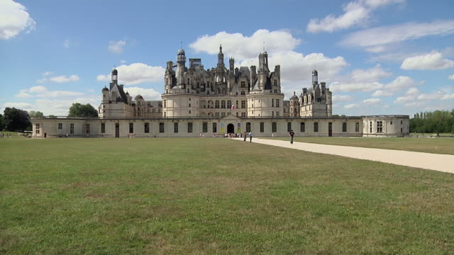 WS Chateaux de Chambord with tourists and man riding horse / Loire Valley, France