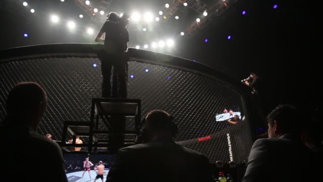 vídeos de stock, filmes e b-roll de chatri sityodtong founder chairman and chief executive officer of one championship center sits ringside during the one kings conquerors event at the... - comentarista