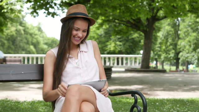 Chatting on a tablet in the park