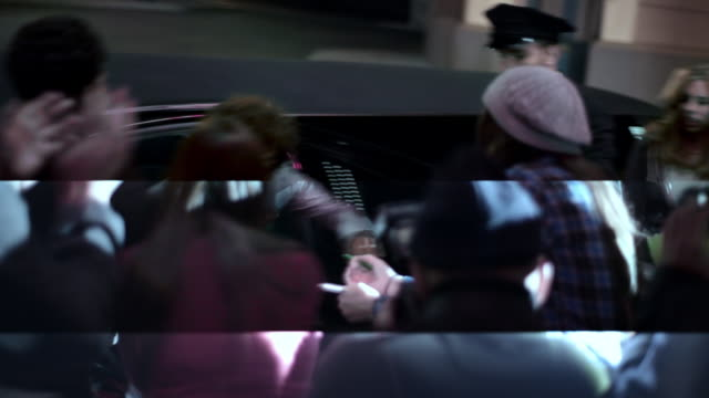 chauffeur opens limousine door, hip-hop artist signs autographs for fans at awards show - autographing stock videos & royalty-free footage