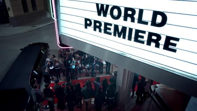 vídeos y material grabado en eventos de stock de chauffeur waits by limousine under world premiere marquee at awards show - gala