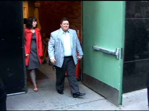 chazz bono makes a quick exit as he leaves good morning america in new york 05/10/11 - good morning america stock videos and b-roll footage