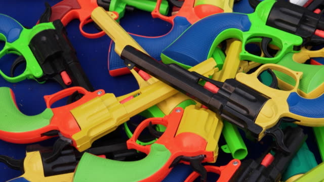 cheap toy guns in bright colours - toy gun stock videos & royalty-free footage