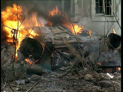 grozny car bomb; chechnya, grozny cms burning wreckage gv extensive damage in street r-l debris and burning wreckage in b/g and more wrecked cars in... - grosny stock-videos und b-roll-filmmaterial