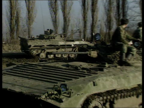 troops reported dead in grozny offensive; russian federation: chechnya: ext head of driver of russian armoured vehicle looking from vehicle as along... - grosny stock-videos und b-roll-filmmaterial