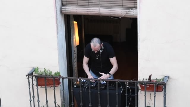 chechuibiza performs at the balcony of his home for the people staying inside as a precaution against the coronavirus outbreak on april 18, 2020 in... - performance stock videos & royalty-free footage