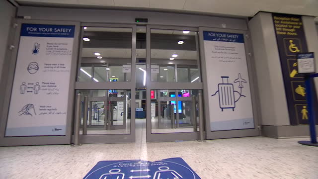 check in desks at a quiet manchester airport with passengers flying to amber list countries for holidays during coronavirus pandemic - decor stock videos & royalty-free footage