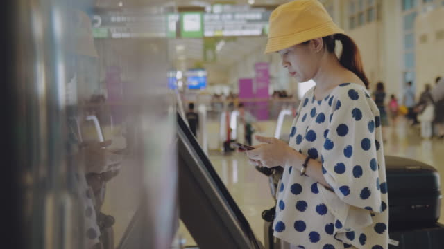 check in flight from kiosk machine - kiosk stock videos and b-roll footage