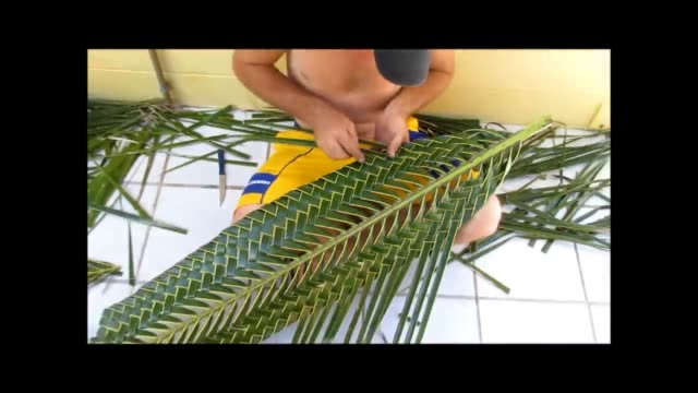 check it out as this talented guy makes a decorative fish with only a coconut leaf. how cool is that? - decorative art stock videos & royalty-free footage