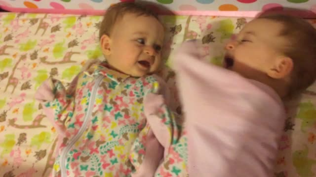 check out these identical twin girls as they still battle with the concept of sharing their mom's experiment shows us that the baby on the right... - identical twin stock videos & royalty-free footage