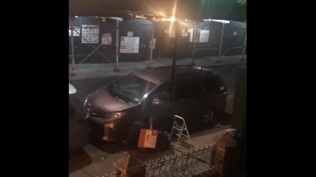 check out this dude using a ladder and screwdriver to take down a 'no parking' sign in the middle of the night so that he can park his car without... - no parking sign stock videos & royalty-free footage