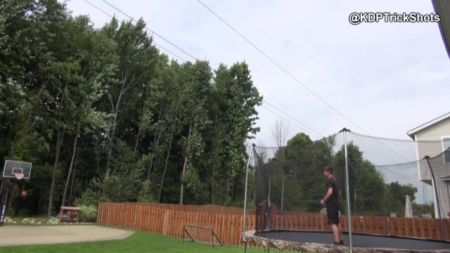 check out this impressive trick shot from kd productions! he manages to pick up a basketball while front-flipping on a trampoline, then sinks a shot... - 曲芸点の映像素材/bロール