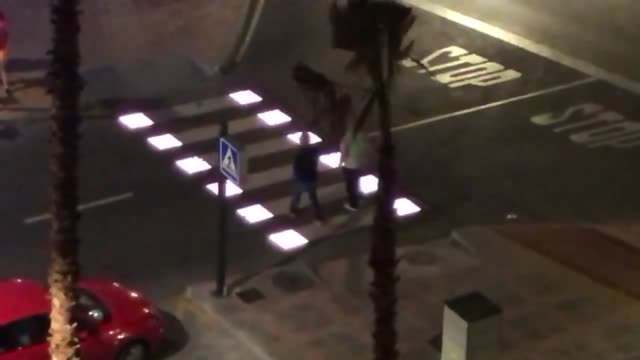 check out this new pedestrian crossing in fuengirola spain as it automatically lights up when one approaches it so cool - altri temi video stock e b–roll