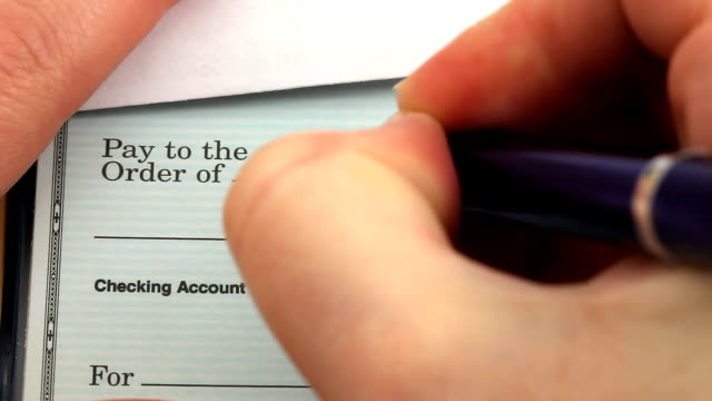 check writing for taxes - cheque financial item stock videos & royalty-free footage