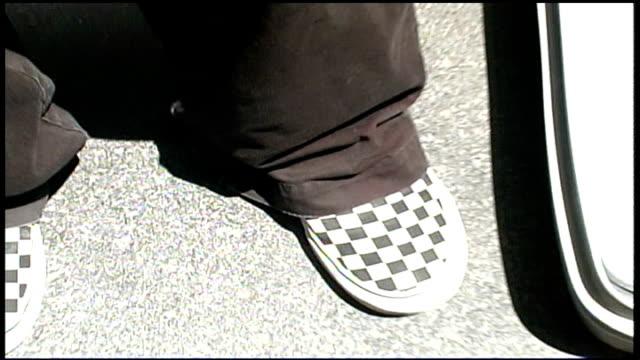 checker board pattern shoes - anno 2002 video stock e b–roll