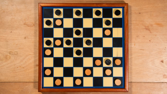 checkers moving across checkerboard - draughts stock videos & royalty-free footage