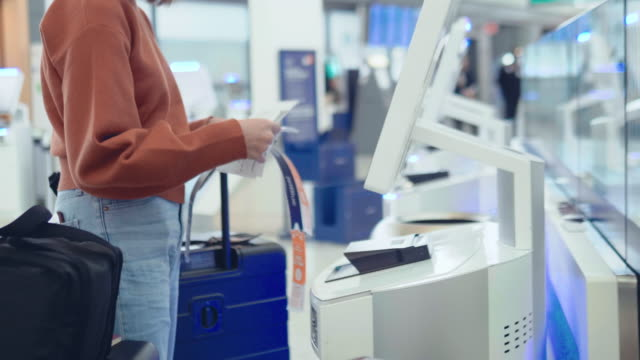 check-in at the airport with self-service machine - self service stock videos & royalty-free footage