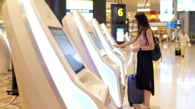 check-in at the airport with self-service machine - touch sensitive stock videos & royalty-free footage