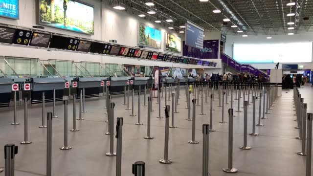 checkin desks are left empty in birmingham airport after the collapse of the family travel firm thomas cook the company was unable to secure the... - airport stock videos & royalty-free footage