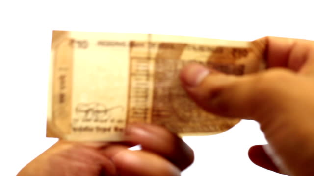 checking 10 rupee note - examining stock videos & royalty-free footage