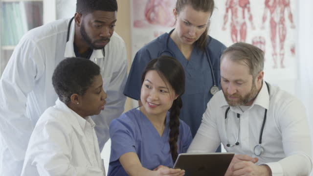 Checking a Patient's Records on a Digital Tablet