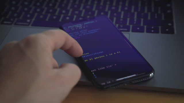 checking computer code on smartphone - computer crime stock videos & royalty-free footage
