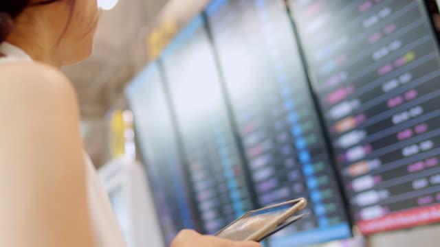 Checking flight at Departure Board
