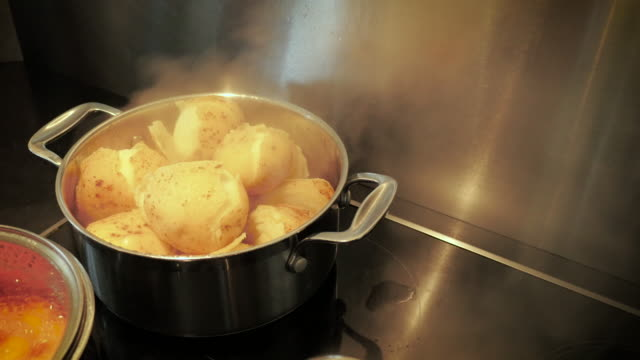 checking if potatoes and carrots are done - prepared potato stock videos & royalty-free footage